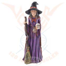 Boszorkány seprűvel és koponyával