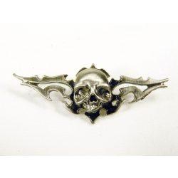 Nonfiguratív koponya jelvény